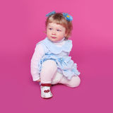 Portrait of funny cute little girl over pink background Royalty Free Stock Photography
