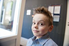 Portrait of funny cute little kid with tousled hair indoors. Portrait of funny little kid with tousled hair indoors Stock Photography