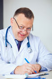 Portrait of funny doctor prescribing drugs. Royalty Free Stock Photography