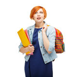 Portrait of a funny emotional red-haired girl making amazedly ro Stock Images