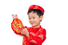 Portrait of a funny and exciting Vietnamese boy with firecracker royalty free stock photos
