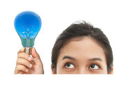 Portrait of funny face and bulb Royalty Free Stock Photo