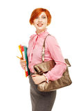 Portrait of funny female teacher holding folders and bag isolate Stock Photos