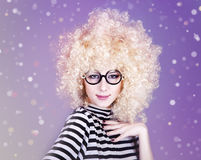Portrait of funny girl in blonde wig. Royalty Free Stock Photos