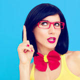Portrait of funny girl on a blue background Royalty Free Stock Photo