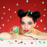 Funny girl with candy drops royalty free stock photography