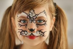 Portrait of funny girl with face painting, close up. View royalty free stock photography