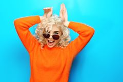 Portrait of funny girl in glasses on background. Portrait of funny girl in glasses on blue background stock images