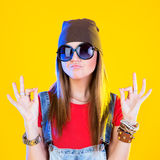 Portrait of funny girl in glasses and a brown hat Royalty Free Stock Photography