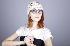 Portrait of funny girl in glasses and white cap. Studio shot stock images