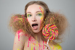 Portrait of funny girl with lollipop Stock Photos