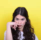 Portrait of funny girl making moustache against yellow backgroun Royalty Free Stock Photos