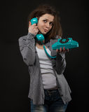 Portrait of the funny girl with old phone Stock Photos