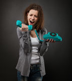 Portrait of the funny girl with old phone Royalty Free Stock Images