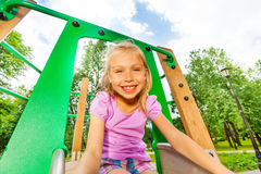 Portrait of funny girl on playground chute Royalty Free Stock Photos
