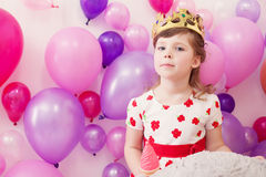 Portrait of funny girl posing in toy crown Stock Images