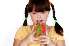 Portrait funny girl with tasty peach isolated Stock Photos