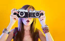 Portrait of funny girl with two cameras Stock Image