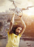 Portrait of a funny guy flying with a drone stock images