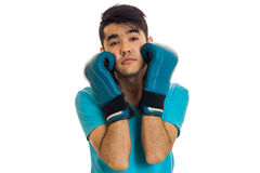 Portrait of funny guy practicing boxing in blue gloves isolated on white background Stock Photography