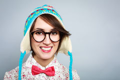 Portrait of Funny Hipster Girl in Winter Hat. Studio Portrait of Smiling Hipster Girl in Funny Winter Hat. Copy Space Royalty Free Stock Photos