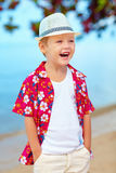 Portrait of funny laughing boy on the beach. Portrait of funny laughing boy, kid on the beach Stock Photo
