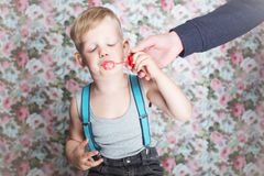 Portrait of funny little boy blowing soap bubbles Royalty Free Stock Photography