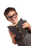 Portrait of a funny little boy holding a books Royalty Free Stock Images