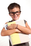 Portrait of a funny little boy holding  exercise b Royalty Free Stock Images