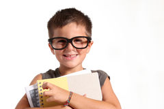 Portrait of a funny little boy holding  exercise b Stock Photos
