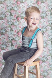 Portrait of funny little boy laughing. Background: floral, soft, pastel Royalty Free Stock Photos