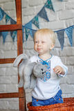 Portrait of a funny little boy with a toy kitten Royalty Free Stock Photo