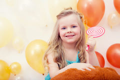 Portrait of funny little model with lollipop Royalty Free Stock Photography
