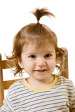 Portrait of funny looking baby boy with long hair Stock Photo