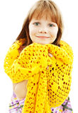 Portrait of funny lovely little girl wearing scarf Stock Photo