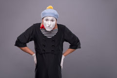 Portrait of funny male mime with grey hat and Royalty Free Stock Images