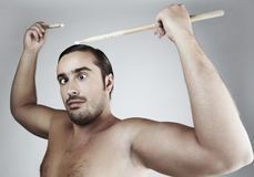 Portrait of funny man Beating drum-type sticks. On his head Stock Photos