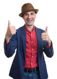 Portrait of a funny man giving thumbs up Royalty Free Stock Images