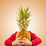Portrait of funny man with pineapple Royalty Free Stock Image