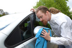 Portrait of funny man washing car. With a cloth Royalty Free Stock Photos