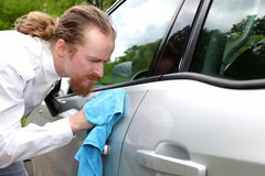 Portrait of funny man washing car. With a cloth Stock Photo