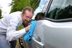 Portrait of funny man washing car Royalty Free Stock Photo