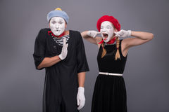 Portrait of funny mime couple with white faces and Stock Photo