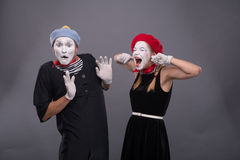 Portrait of funny mime couple with white faces and Stock Photos