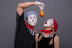 Portrait of funny mime couple with white faces and Royalty Free Stock Photos