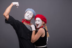 Portrait of funny mime couple with white faces and Royalty Free Stock Photography