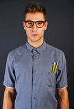 Portrait of funny nerd man with pencyls and glasses over black b Royalty Free Stock Photography