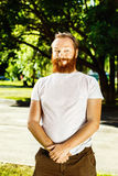 Portrait of funny red hair bearded man with curious face Stock Images