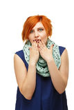 Portrait of a funny red-haired girl emotionally gesticulating an Stock Photography