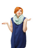 Portrait of a funny red-haired girl emotionally gesticulating an Royalty Free Stock Photography